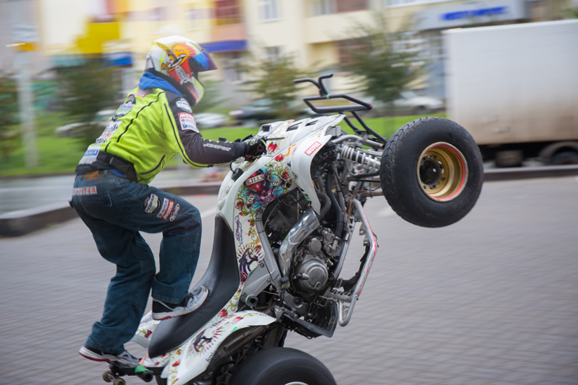 A stunt rider entertains the crowd at the grand opening, whist showcasing the quality of tyres fitted by a specialist at the new Kolesa Darom tyre centre opening.